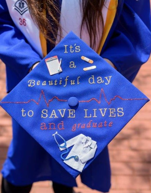 A future Physician Assistant shows off her mortarboard