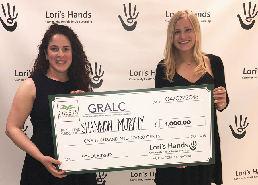 Sarah LaFave, the Board President of Lori's Hands, presenting award to Shannon Murphy