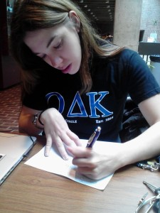 Caitlin Zibreg writing letters to veterans.