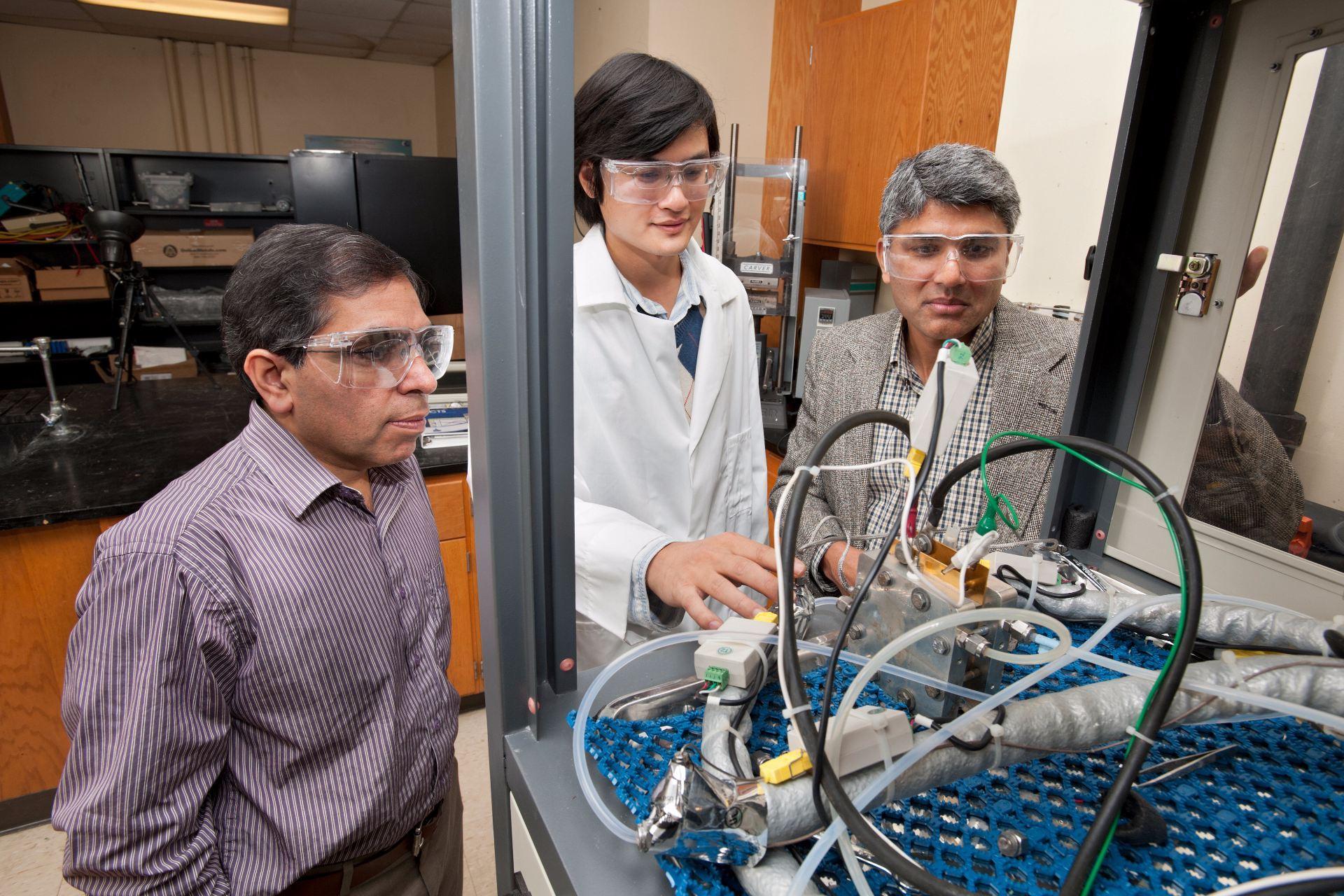 researchers near lab equipment