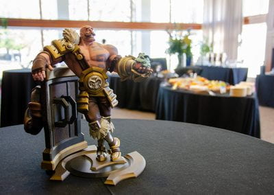 Statue of a video game character with catering tables in the background