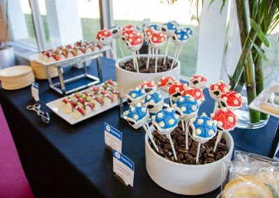 Cake pops decorated as blue and red Koopa shells