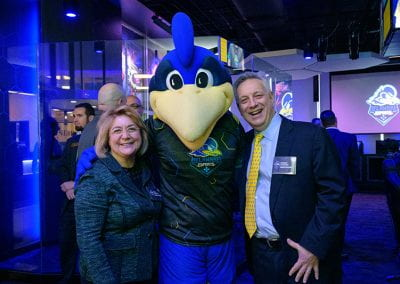 President Assanis poses with First Lady Assanis and YoUDee