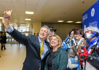 President and First Lady Assanis take a selfie with Overwatch cosplayers