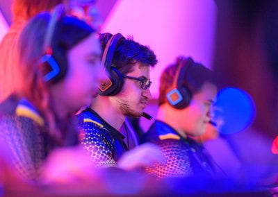 Students play at a row of video game stations