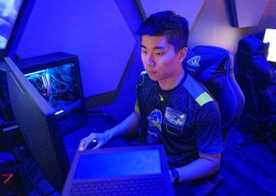 John Kim sits at one of the gaming stations
