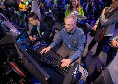Guests try their hand at the video game stations