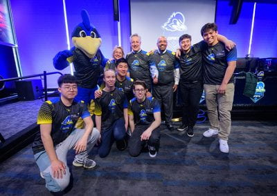 Esports players pose with President and First Lady Assanis, José-Luis Riera and YoUDee