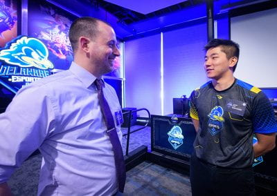 John Kim speaks with a guest