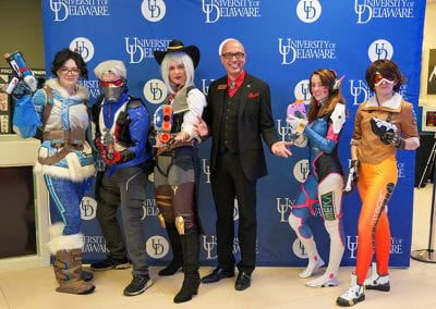 USC staff poses with Overwatch Cosplayers