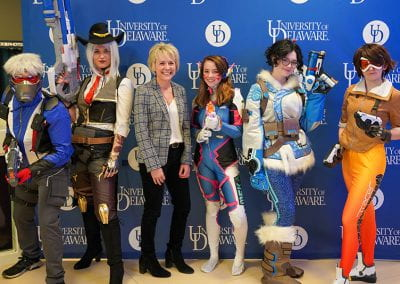 Student Life staff poses with Overwatch cosplayers