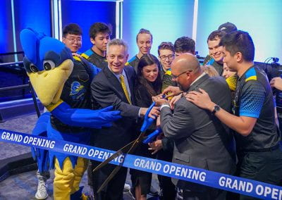 President Assanis, José-Luis Riera, YoUDee and Esports players cut the ribbon