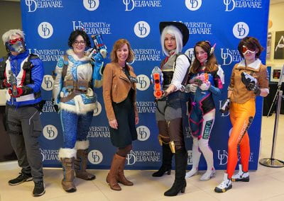 UD staff member poses with Overwatch cosplayers