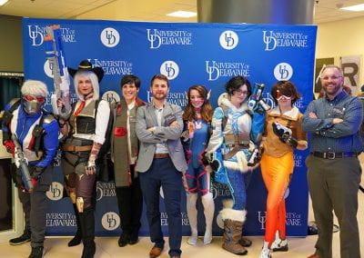 UD staff poses with Overwatch cosplayers