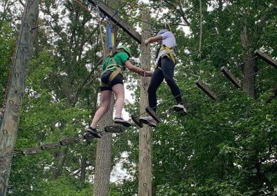QUEST Students climbing an obstacle course in the trees