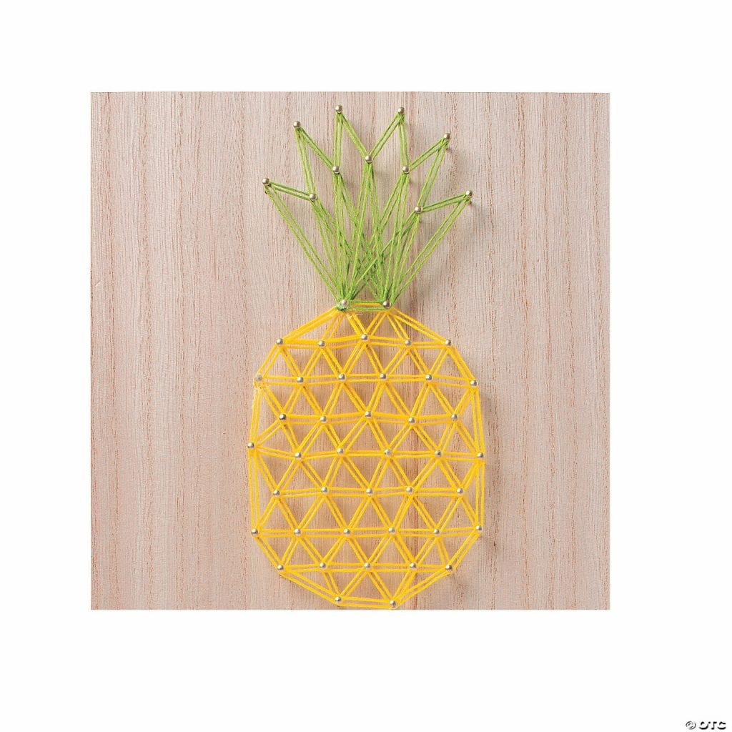 Board with nails, with yellow and green string looped around making a pineapple shape
