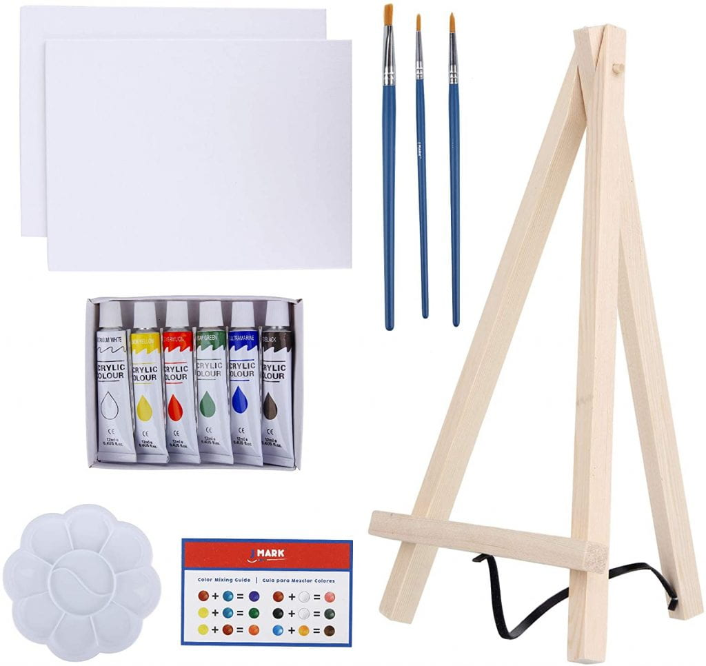 Easel, paintbrushes, acrylic paints and blank canvases