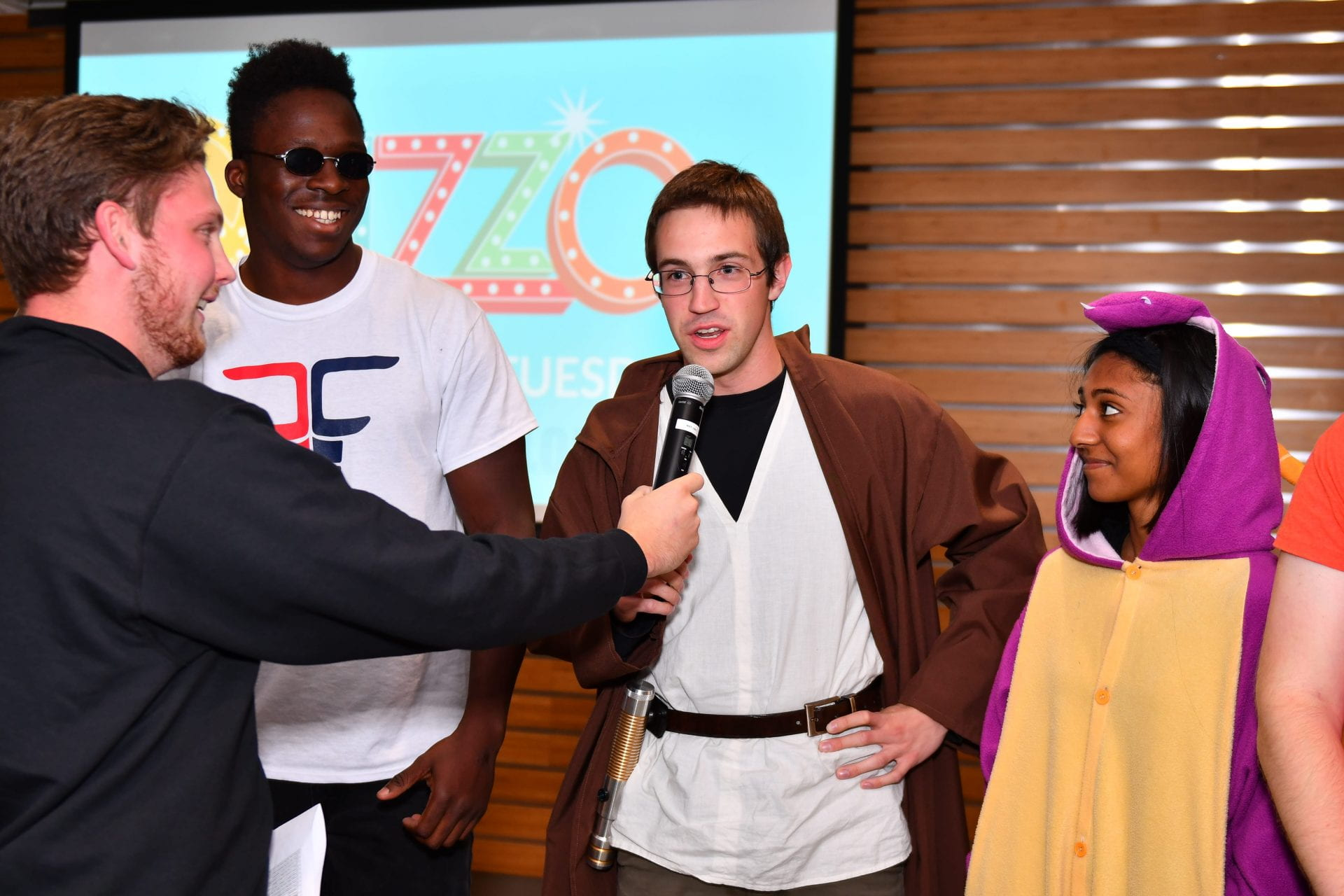Student in costume answer trivia question at Halloween Quizzo.