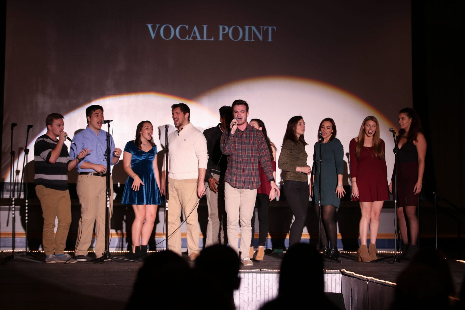 Vocal Point student singing group perform at UDress fashion show.