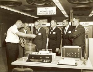 Men Looking at Computer Tapes
