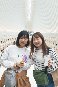 Two students from Nagasaki stand in the oculus at the new World Trade Center in New York City.