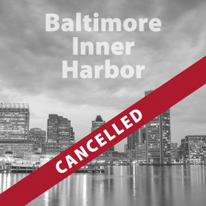 Baltimore Inner Harbor trip cancelled text over greyed out photo of city skyline over glassy harbor waters