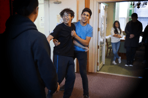 Two students act out a fight scene from The Man Who Moved a Mountain, which was another fable portrayed in Wednesday's Five Minute Fairy Tales.