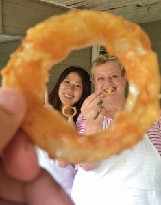 Nancy Turner and a student seen through the center of an onion ring!