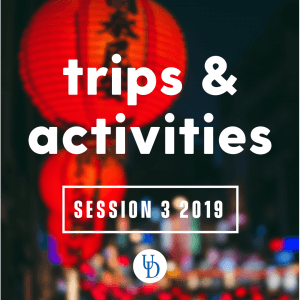 Blurred shot of red lantern and lights with text: trips & activities Session 3 2019