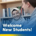 "Two students talking at the library with text ""Welcome New Students!"""