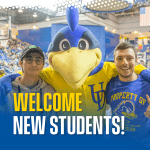 Two students pose with YoUDee at the Acierno Arena at the Bob Carpenter Center. Text reads: Welcome New Students!