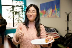 A student enjoys snacks and gives a thumbs up during the event hosted by the SSA.