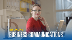 "This image is a stock photo of a student working at a computer while smiling toward the camera. The photo is overlaid by the text, ""ELI Online: Business Communications""."