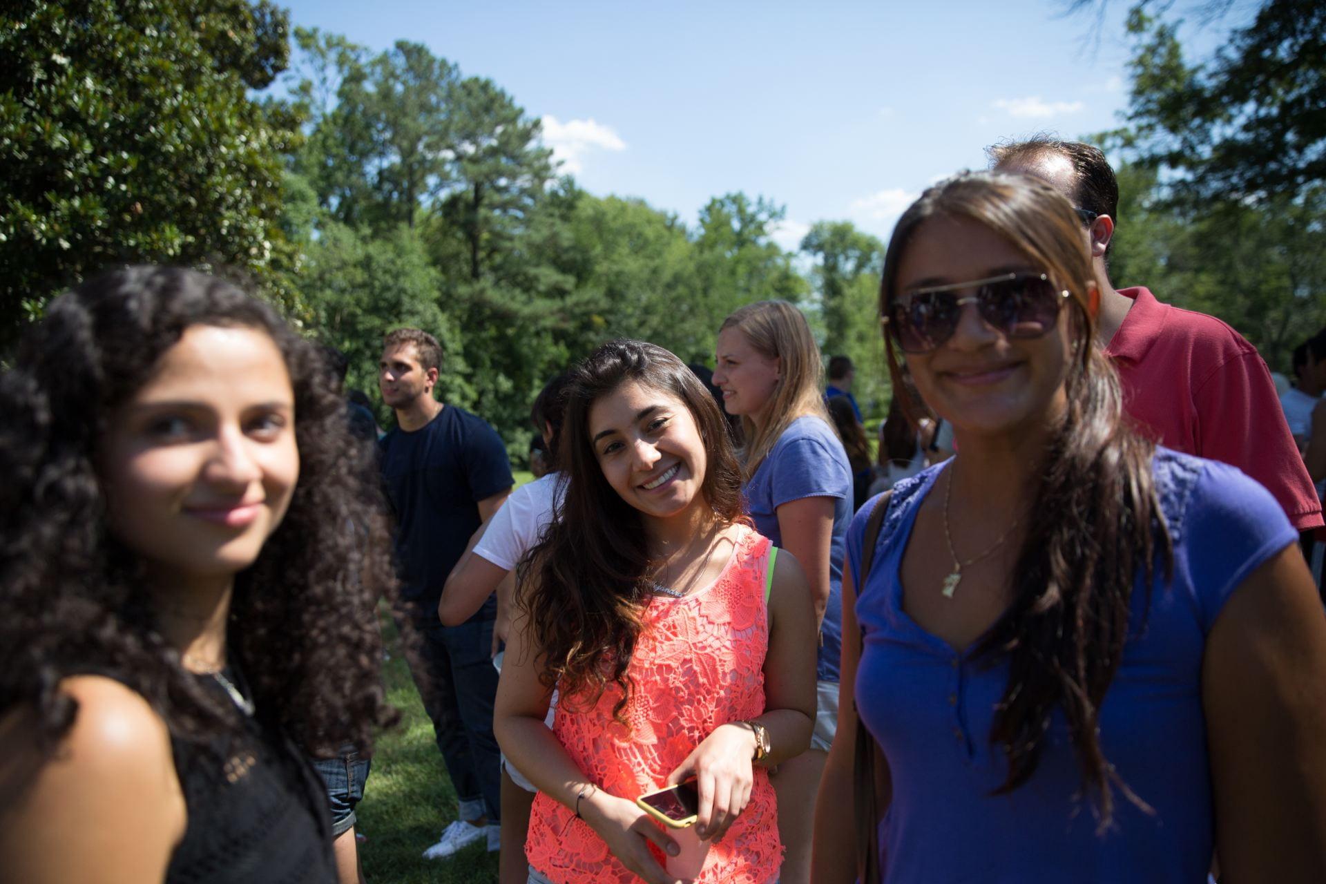 Three students at an ELI picnic