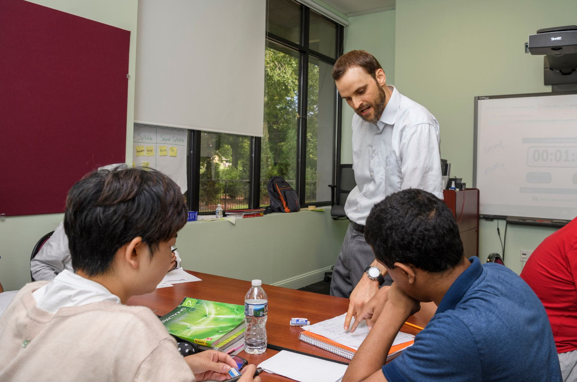 An ELI instructor works with students