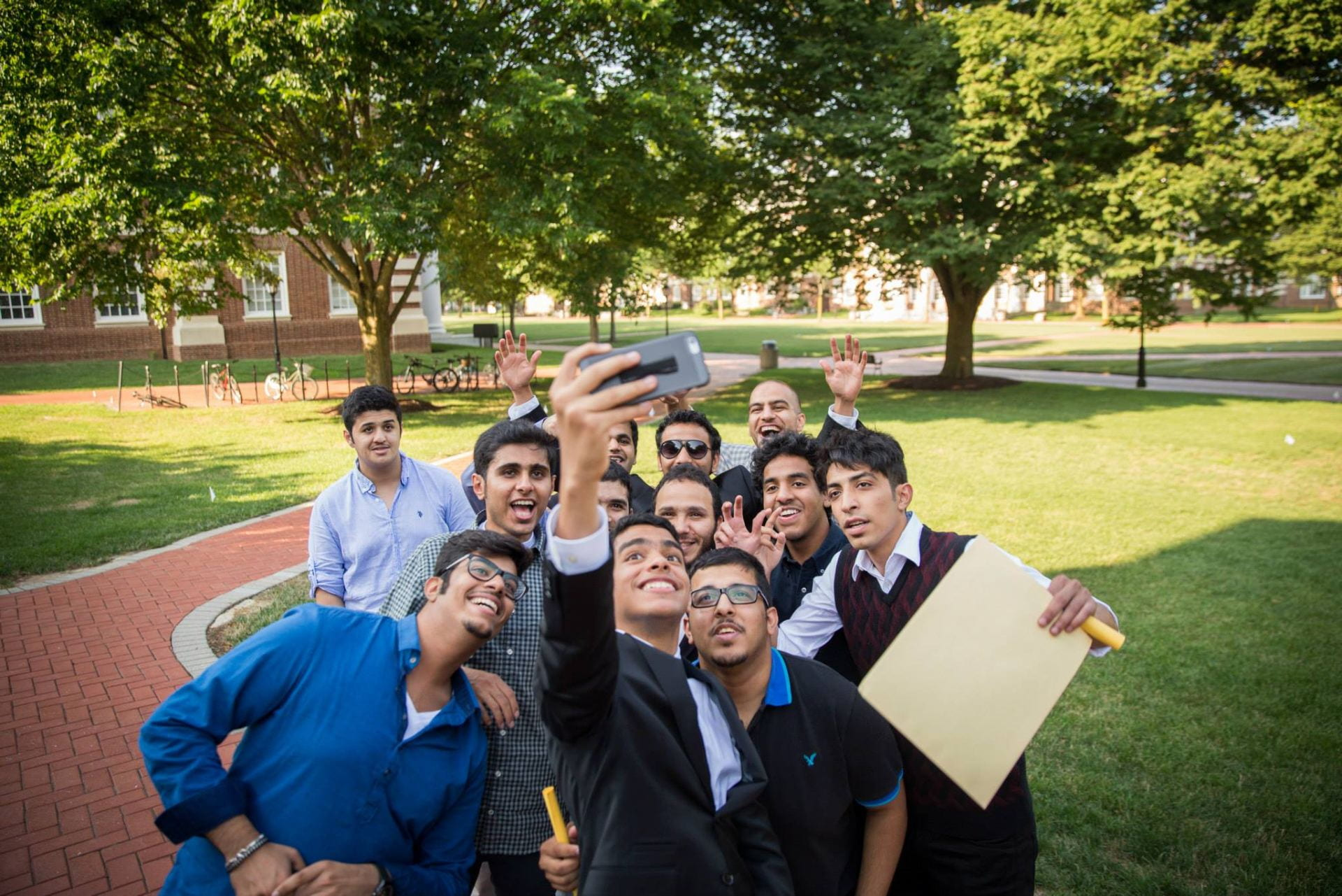 A group of students taking a group selfie after graduation
