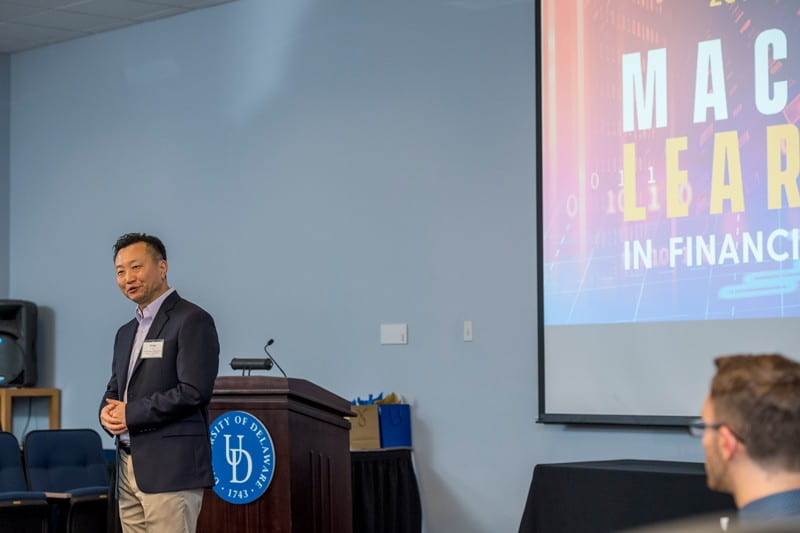 """UD Prof. Bintong Chen introduces the first speaker during the """"Machine Learning in Financial Services"""" conference, hosted by Lerner College and its Institute for Financial Services Analytics (IFSA) at Clayton Hall."""