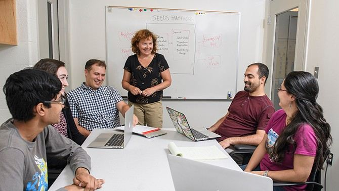 Computer Science Professor Lori Pollock with colleagues