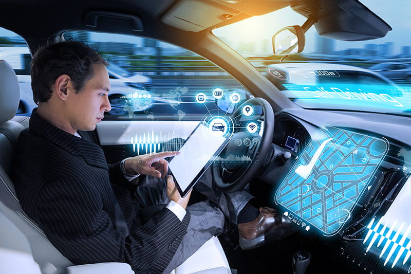Man reading tablet in self-driving vehicle