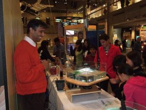Visitors check the surface parabola at the Boston Museum of Science