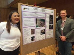 Cheyanne Koran presents her research at WISC-AMP symposium with mentor Scott Schaefer