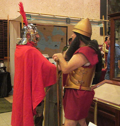Greek and Roman soldiers chat