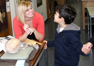 Adrienne Frie, UW-Milwaukee, explains nutrition and the human body to a young visitor. Photo A. Rivera.
