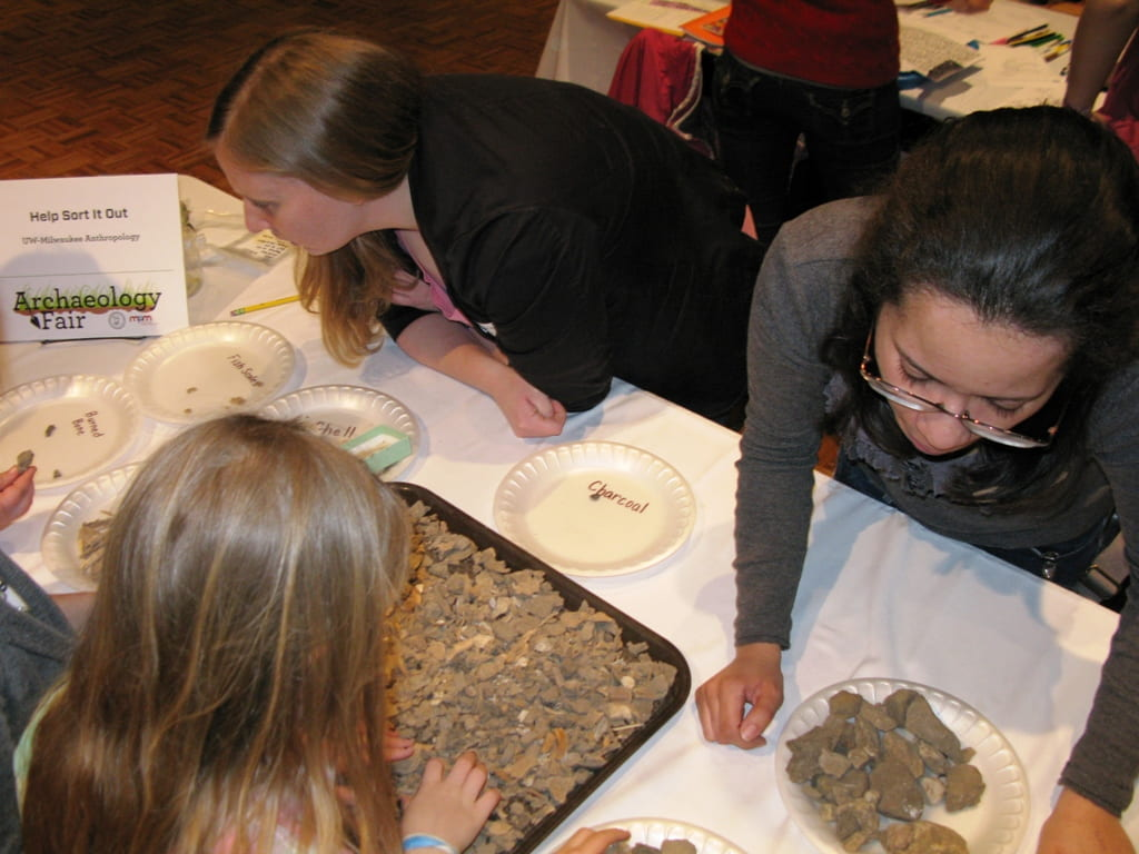 Kids help sort out artifacts from flotation