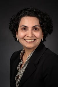 Studio portrait of Priya Nambisan, Assistant Professor in the College of Health Sciences (CHS).