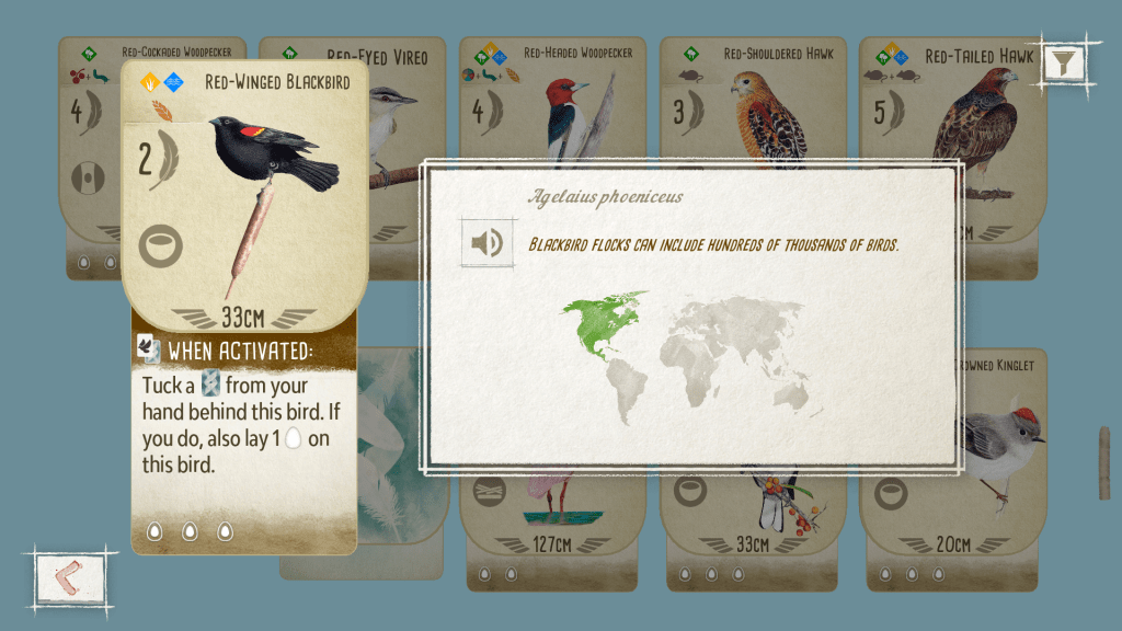 Entry for a red-winged blackbird in Wingspan. There is a picture of the bird on the game card, and a map of the world with North America highlighted in green, demonstrating where this bird lives.