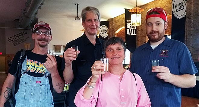 Mike Vergolina, Russ Klisch, Bettina Arnold and Chad Sheridan toast photographer Chris Ranson in samples of Keltenbräu #2