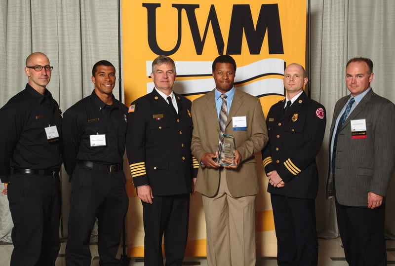 Members of the Milwaukee Fire Department with their CHS Community Partnership Award.
