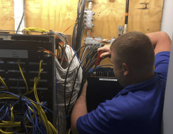 Network technician installing electronics