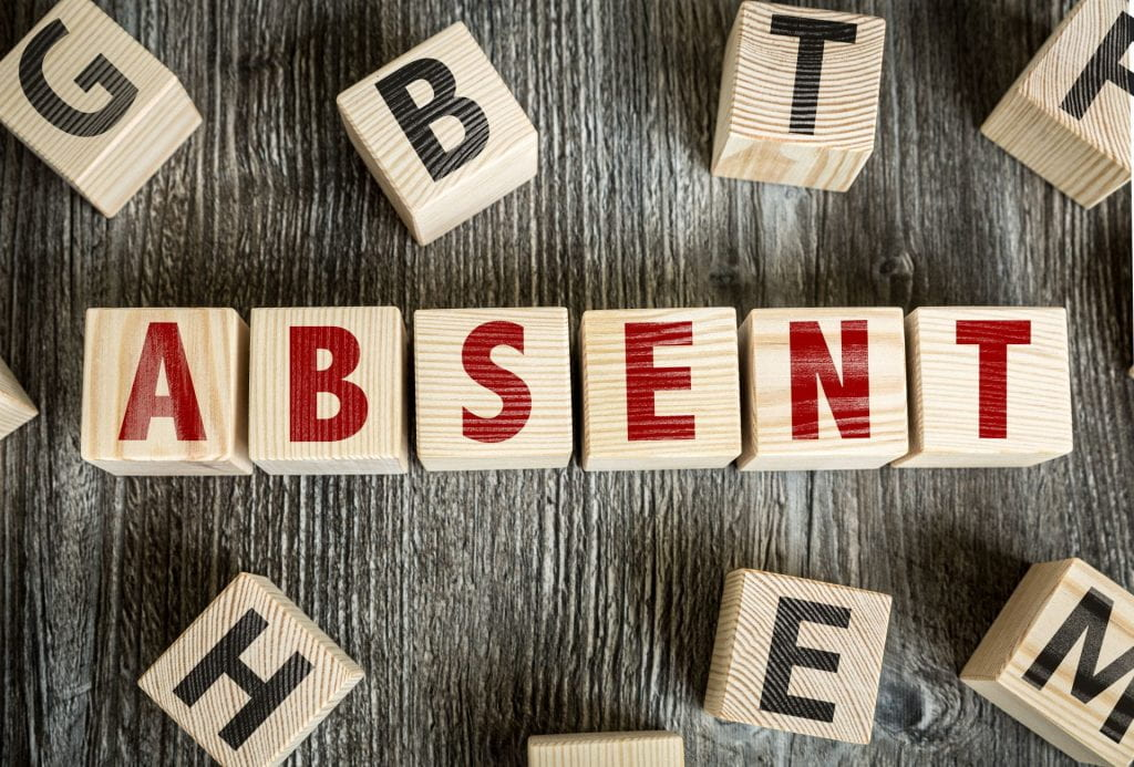 "Wooden Blocks spelling the word  ""Absent"""